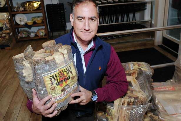 Paul Borde, a Greatest Blaze & Co. executive, with Pinon Firewood at the Market at Gus's in Harrison, N.Y., Tuesday, Nov. 29, 2016. The specialty wood is from the west coast of America and is sold at the Market at Gus's along with other Greatest Blaze products. Greatest Blaze & Co. sells a wide range of hand-picked products tailored to the wood-burning fire products sector.