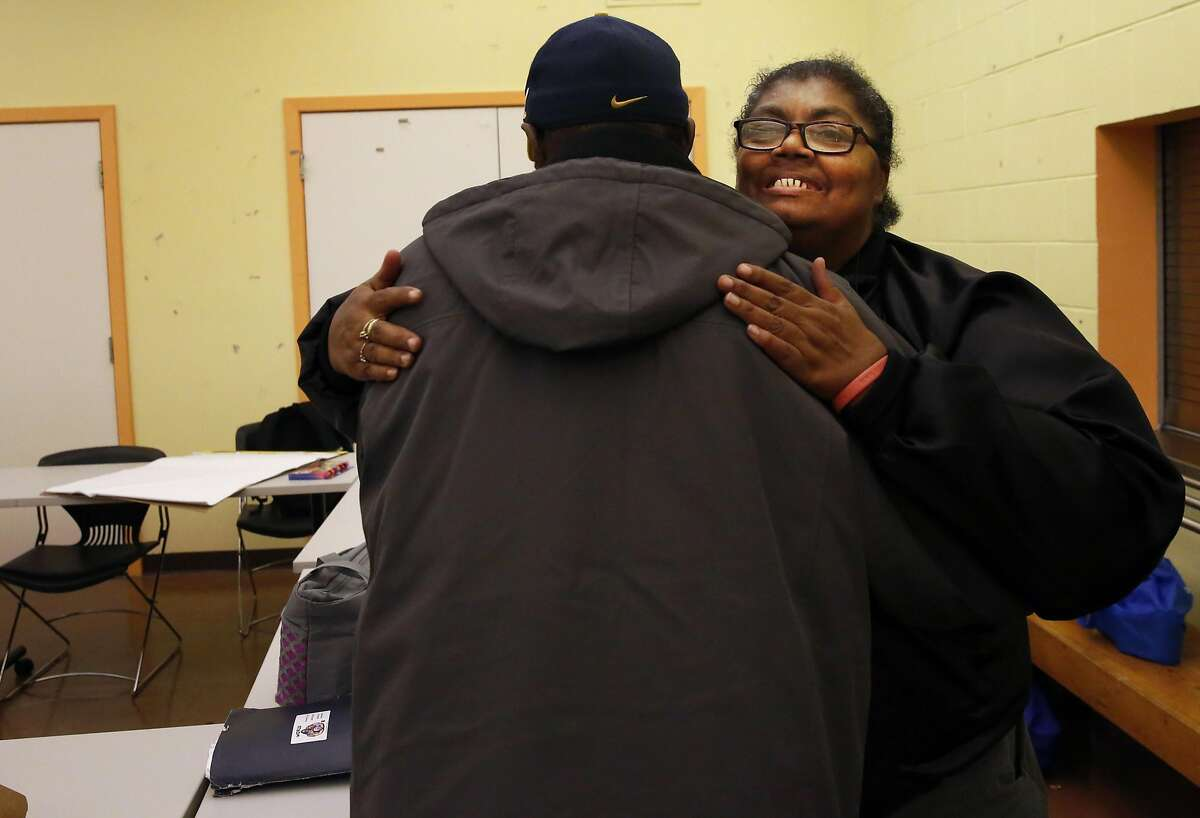 Anita Schools hugs Gregory Ward at a community meeting Nov. 15, 2016 with the East Bay Housing Organization, a local group she is involved with about affordable housing access, education and community organizing at Oakland Housing Authority in Oakland, Calif. Schools has been living with HIV for years and is involved in many different groups and organizations in her area focused not only on HIV but also her community and advocacy of different types.