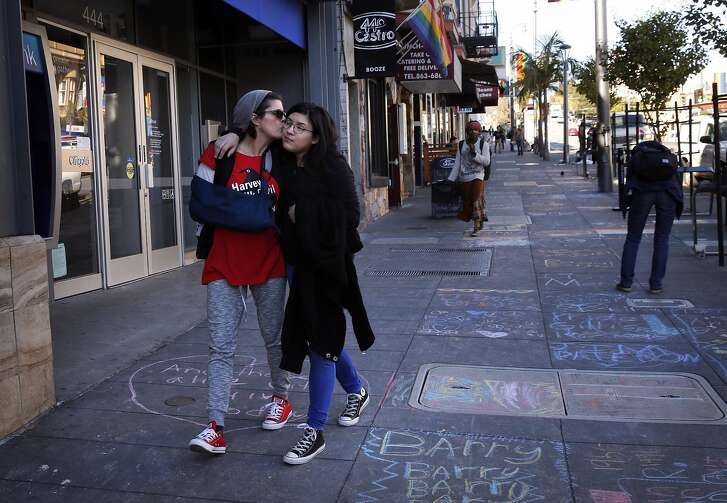 Patti Radigan, 59, kisses her daughter Angelica Tom�, 20, on the cheek after they participated in INSCRIBE, a sidewalk memorial to AIDs victims drawn along Castro street on World AIDs Day Dec. 1, 2016 in San Francisco, Calif. Radigan has been HIV positive for 25 years and has throughout her life been through many difficult times including drug addiction, prostitution and losing her first husband to a heart attack right in front of her. Though her third child was born while Radigan was HIV positive, the child, Angelica Tom�, turned out to be negative. It was the birth of Angelica that helped inspire Radigan to turn her life around.