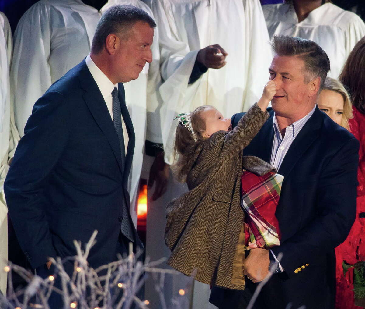 Mayor Bill de Blasio, left, Carmen Baldwin and Alec Baldwin attend the 84th Annual Rockefeller Center Christmas Tree lighting ceremony on Wednesday, Nov. 30, 2016, in New York. (Photo by Charles Sykes/Invision/AP) ORG XMIT: NYCS106