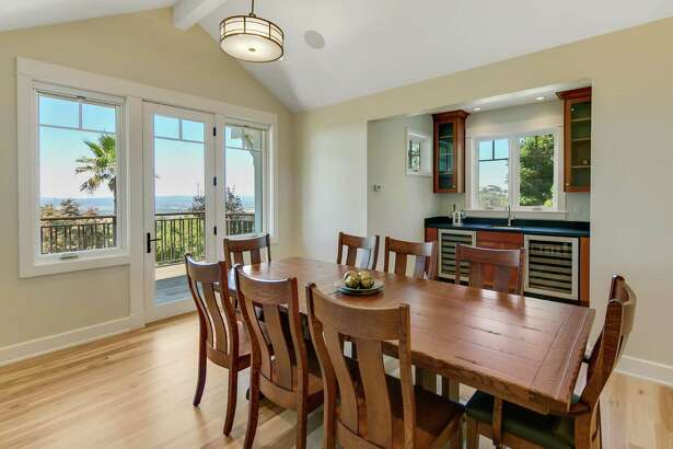 The dining room includes a wet bar and deck access.
