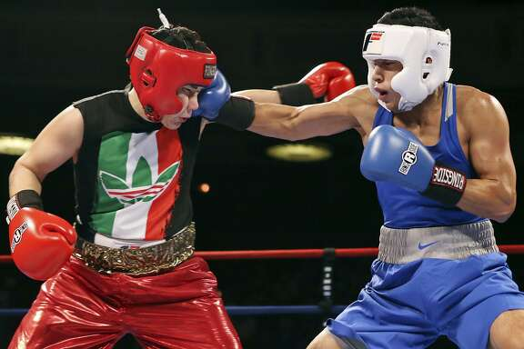 Jesse Rivera (left) is hit by Joshua Moreno during their open welterweight championship bout part of the 2015 San Antonio Regional Golden Gloves boxing tournament finals on Feb. 21, 2015 at the Scottish Rite Auditorium.
