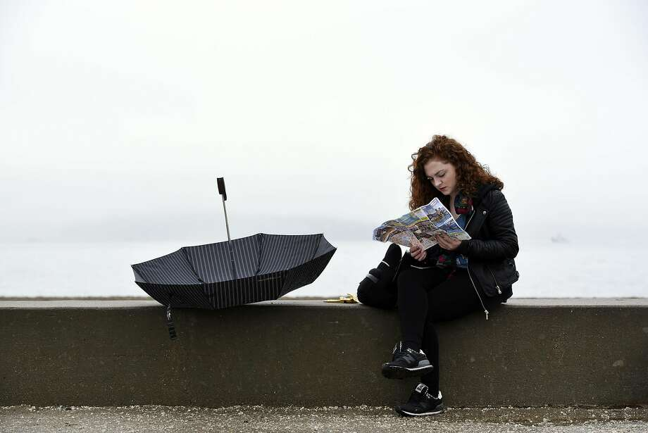 Caoimhe Burke, visiting from Dublin, Ireland, looks at her map during a break in the rain at Crissy Field in San Francisco, CA, on Thursday, December 8, 2016. Photo: Michael Short, Special To The Chronicle