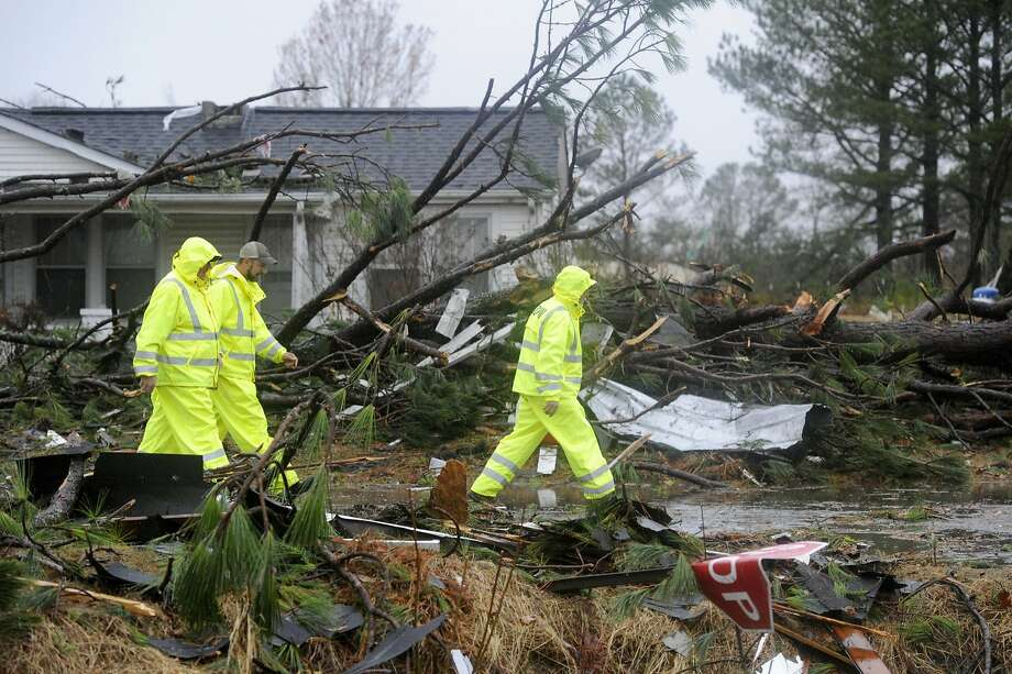 Workers walk through the wreckage left behind by a storm in Rosalie, Ala., last month. Recent precipitation, though welcome, has not been enough to reverse the region's severe drought. Photo: Eric Schultz, Getty Images