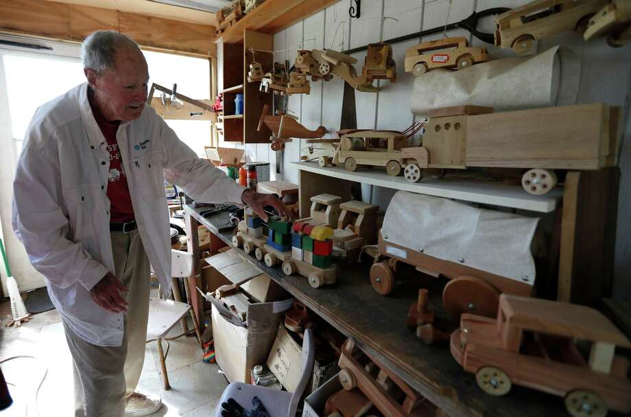 In his garage, Raines shows off a toy train. Growing up, he watching trains at the station. Photo: Karen Warren, Houston Chronicle / 2016 Houston Chronicle
