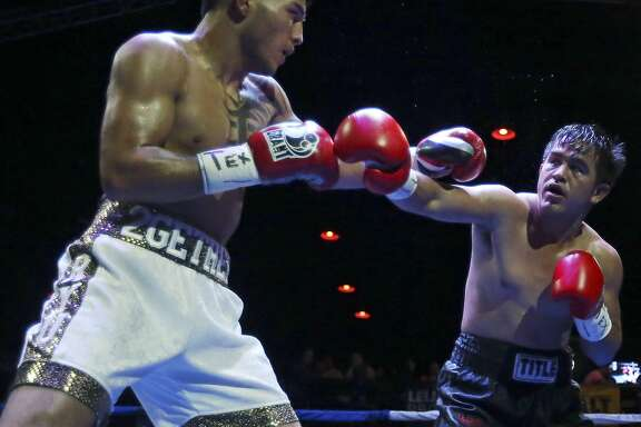 Jairo Castaneda (left) and Albert Espinoza exchange punches during their junior middleweight bout on Dec. 8, 2014 at Cowboys Dancehall. Castaneda won by a unanimous decision.