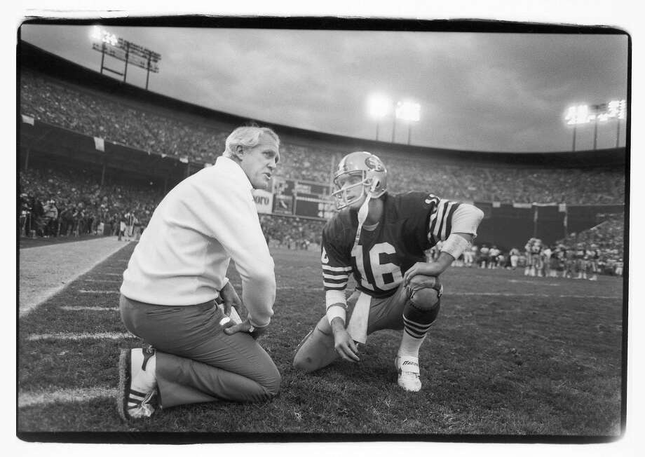 Head coach Bill Walsh of the San Francisco 49ers talks to quarterback Joe Montana #16 during the 1984 NFC Championship Game against the Chicago Bears at Candlestick Park on January 6, 1985 in San Francisco, California. The Niners defeated the Bears 23-0.  Photo: Michael Zagaris, Getty Images