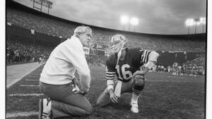 SAN FRANCISCO - JANUARY 6:  Head coach Bill Walsh of the San Francisco 49ers talks to quarterback Joe Montana #16 during the 1984 NFC Championship Game against the Chicago Bears at Candlestick Park on January 6, 1985 in San Francisco, California. The Niners defeated the Bears 23-0. (Photo by Michael Zagaris/Getty Images)