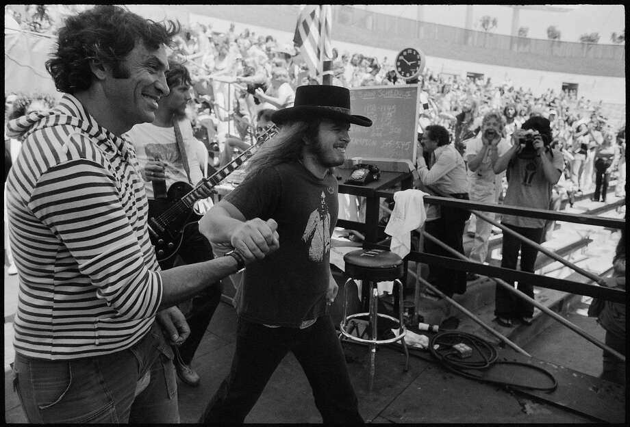 """Ronnie Van Zant and Bill Graham at the Lynyrd Skynyrd Day on the Green in July 1977, from """"Total Excess"""" by Michael Zagaris. Photo: Michael Zagaris, Reel Art Press"""