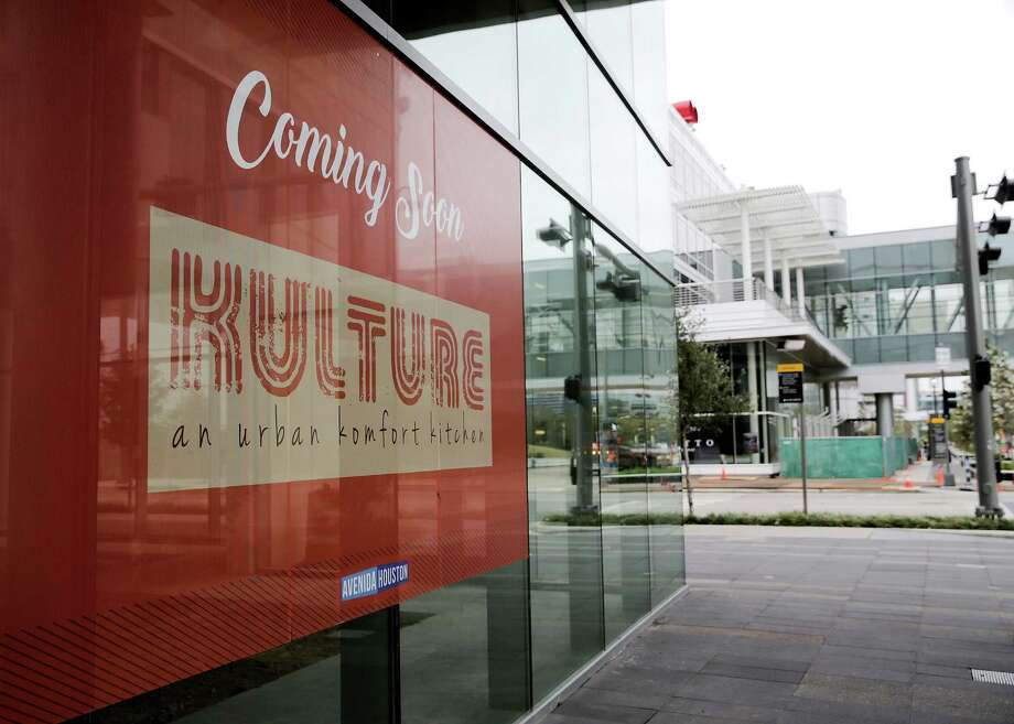 A sign in front of the George R. Brown Convention Center promotes Kulture, one of a spate of new restaurants set to open near Discovery Green. (For architects' renderings and more photos, scroll through the slideshow.) Photo: Elizabeth Conley, Houston Chronicle / © 2016 Houston Chronicle