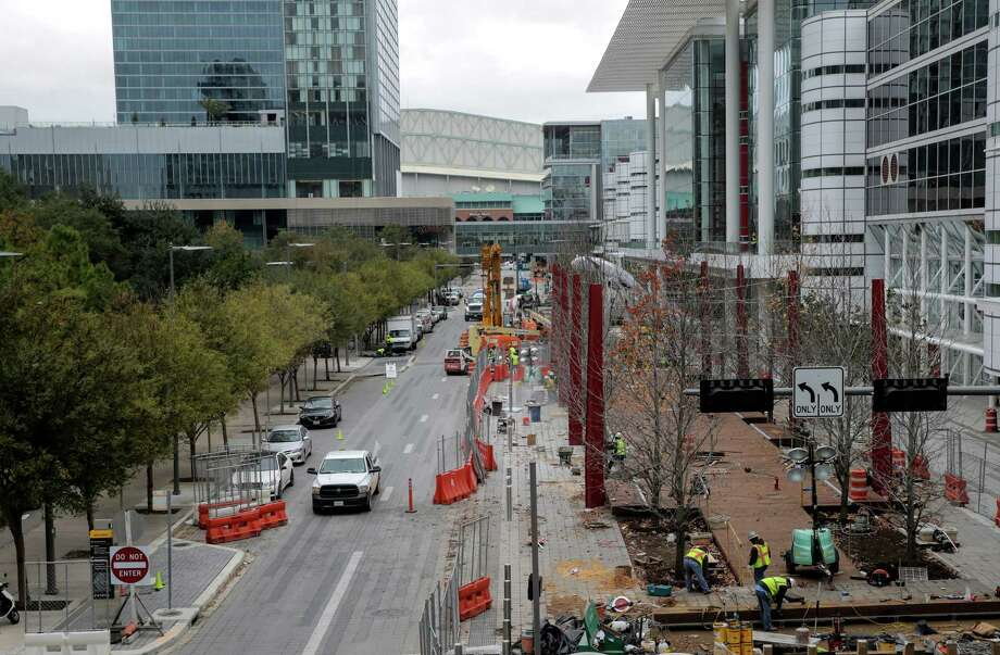 Construction for on Avenida, the pedestrian promenade in front of the George R. Brown Convention Center which aims to open five new restaurants before Super Bowl LI. Coupled with six concepts going into the Marriott Marquis Houston it makes for a new restaurant row around the Discovery Green area. Photo: Elizabeth Conley, Houston Chronicle / © 2016 Houston Chronicle
