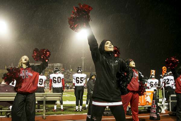 Lauren Garlock, 17, cheers for her team, the Iraan High School Braves, at the quarter-final game in Colorado City, Texas, Dec. 2, 2016. Hours after an away-game victory, a bus full of Iraan High's cheerleaders was involved in a rainy collision with an 18-wheeler, injuring many, including Garlock's mother, and killing her aunt, who served as the sponsor of the junior high cheerleaders. (Ilana Panich-Linsman/The New York Times)