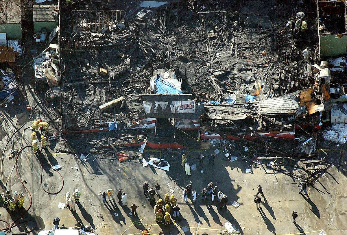 WEST WARWICK, RI - FEBRUARY 21: Station nightclub fire scene, viewed from above. The one-story building burned to the ground in about three minutes. The fire was started by pyrotechnics going off on the stage while the band Great White performed. View of the front door. (Photo by David L Ryan/The Boston Globe via Getty Images)