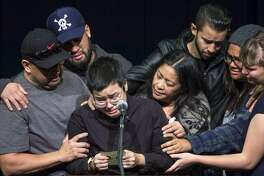 Victoria Plotkin reads from a note she wrote to her sister Vanessa Plotkin, as she is embraced by family and friends on Thursday, Dec. 8, 2016 in Berkeley, Calif. Vanessa, 21, who was Victoria's twin sister, died in the Oakland warehouse fire last week. A vigil was held at Zellerbach Hall for Berkeley undergraduates Jennifer Morris and Vanessa Plotkin, and recently graduated alumni David Cline and Griffin Madden, who all died in an Oakland warehouse fire. 36 people were killed when the fire broke out at the Ghost Ship warehouse on 31st Avenue and International Boulevard in Oakland's Fruitvale neighborhood.
