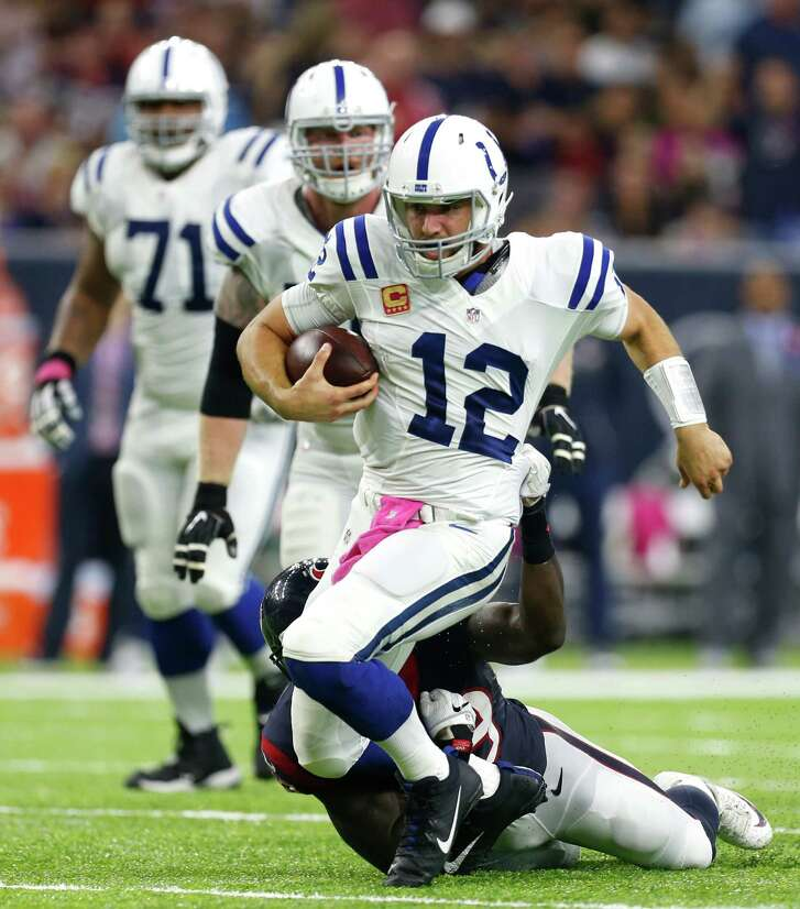 Indianapolis Colts quarterback Andrew Luck (12) is brougtht down by Houston Texans outside linebacker Whitney Mercilus (59) after he was forced from the pocket during the second quarter of an NFL football game at NRG Stadium on Sunday, Oct. 16, 2016, in Houston.