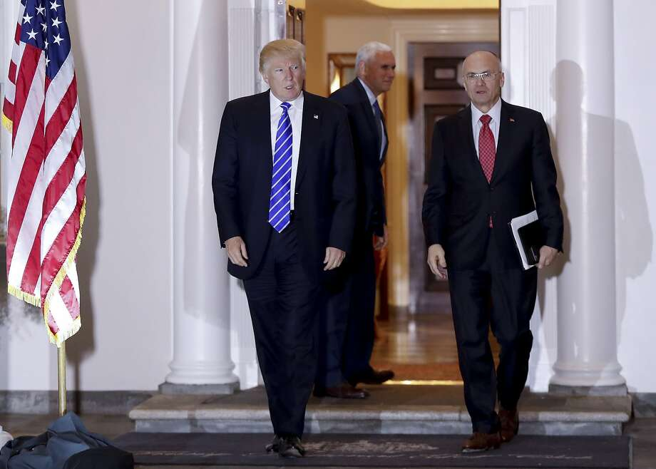In this Nov. 19, 2016 file photo, President-elect Donald Trump walks with CKE Restaurants CEO Andy Puzder from Trump National Golf Club Bedminster clubhouse in Bedminster, N.J.  Photo: Carolyn Kaster, Associated Press