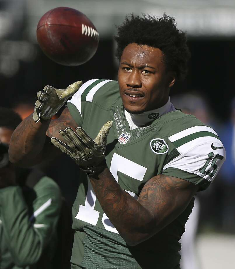 FILE - In this Nov. 13, 2016, file photo, New York Jets wide receiver Brandon Marshall (15) warms up before playing against the Los Angeles Rams, in East Rutherford, N.J. Arizona's Larry Fitzgerald, Miami's Mike Pouncey and the New York Jets' Brandon Marshall are among the 32 players eligible for the Walter Payton NFL Man of the Year Award. Named for the late Hall of Fame running back, the award recognizes a player's community service and performance on the field. The NFL announced the players on Wednesday, Dec. 7, 2016. (AP Photo/Seth Wenig, File) Photo: Seth Wenig, Associated Press