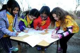 "From left, Mritika Omkumar, Isabella Morales, Ashlyn Rufus and Hannah Boxall, student members of the Girls on the Run, a new girl's empowerment program for girls in the 3rd through 5th grade at Stamford's Toquam Magnet Middle School, complete an exercise on their final meeting  on Dec. 8, 2016  before the holiday break at the school. This past Sunday the group did a 5K run as part of the Jingle Bell Jog in Greenwich to mark the end of the semester.   Girls on the Run is a national program focusing on, ""Girls empowerment, positive thinking, social skills and healthy lifestyle."""