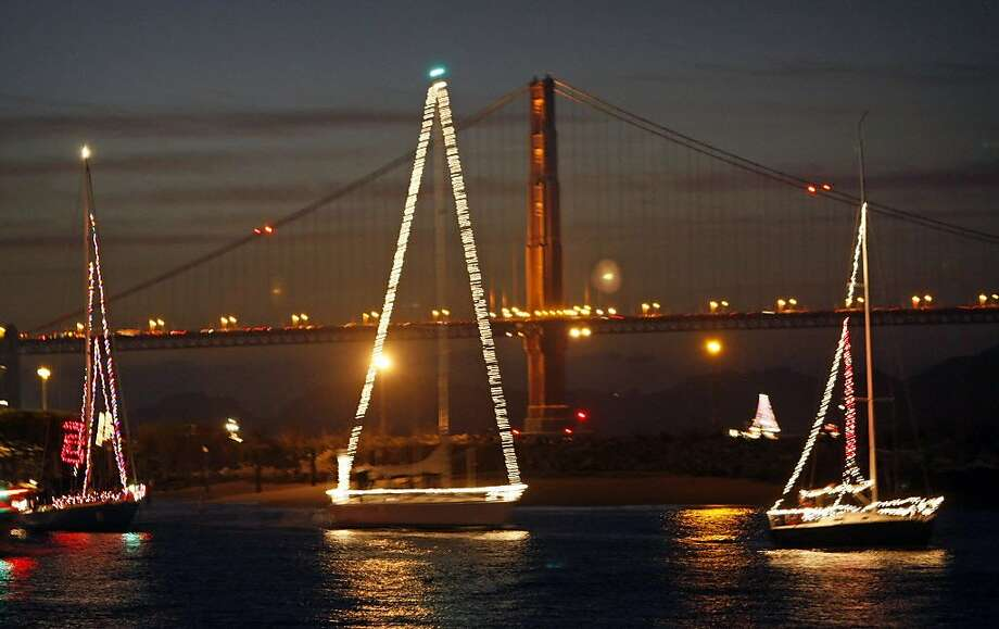 More than 100 boats were decked out for the holidays with lights and decorations, and sailed by the San Francisco waterfront in this file photo. The San Francisco boat parade is set for Friday, Dec. 16 at 6 p.m. The parade will launch near Pier 39 and head towards Crissy Field. Photo: Lance Iversen, SFC
