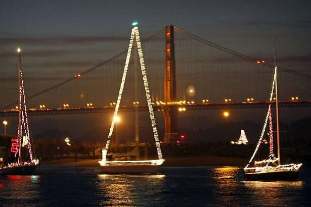 LIGHTS15_PBX_92565.JPG More than 100 boats all decked out for the holiday's with lights and decorations toured San Francisco waterfront in a boat parade Friday night. The tour started in front of  Fort Mason piers, and proceeds west toward Crissy Field. Lance Iversen/San Francisco Chronicle (cq) SUBJECT 12/14/07,in SAN FRANCISCO Ca.       Ran on: 12-15-2007 Boats festooned with lights and an array of decorations take part in Friday night's maritime parade along the San Francisco waterfront. The craft began their route in front of the piers at Fort Mason and headed west toward Crissy Field. More than 100 boats participated in the event to celebrate the holidays. A few of them are captured here at sunset against the backdrop of the Golden Gate Bridge. Ran on: 12-15-2007