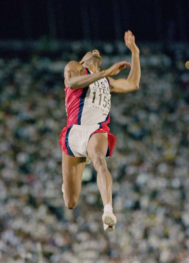 Mike Powell of the United States leaps into the record book on Aug. 30, 1991, with a long jump of 29-41/2, breaking Bob Beamon's mark, which had stood for two-plus decades. Photo: Mike Powell, Staff / 2014 Getty Images