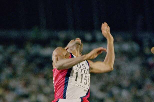 Mike Powell of the United States leaps into the record book on Aug. 30, 1991, with a long jump of 29-41/2, breaking Bob Beamon's mark, which had stood for two-plus decades.