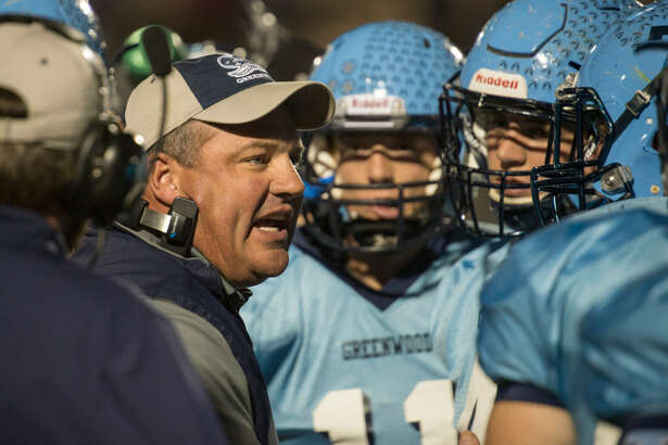 Greenwood coach Shad Hanna talks with his players during a timeout Friday 10-21-16 against Pecos at J.M. King Memorial Stadium. Tim Fischer/Reporter-Telegram