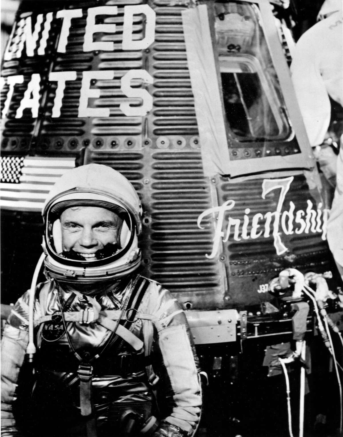 John Glenn with his Mercury space capsule, Friendship 7, in an undated handout photo. Glenn, who was hailed as a national hero and a symbol of the space age as the first American to orbit Earth, then became a national political figure for 24 years in the Senate, died on Dec. 8, 2016. He was 95. (NASA via the New York Times)