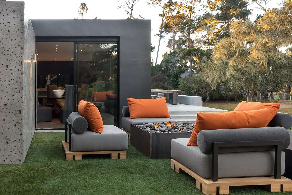 Just beyond the dining area rests a patio anchored by gas fire box.