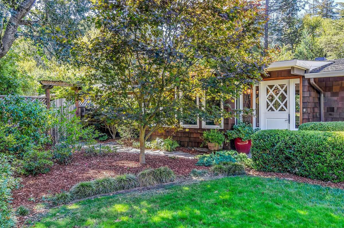 The shingled four bedroom offers roughly 2,550 square feet of living space.