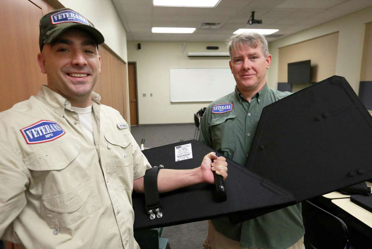Katy-based Veterans MFG co-owners Michael Hlozek, left, and Billy Gibbons pose for a photo with the bulletproof shields that they developed and sold to Katy Police Department Thursday, Dec. 8, 2016, in Katy. ( Yi-Chin Lee / Houston Chronicle )