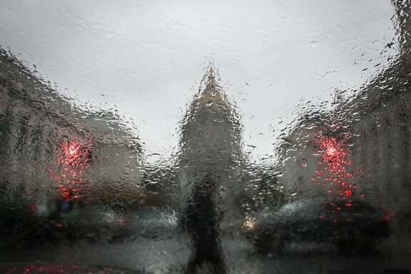 The Civic Center is seen through a rain covered window on Thursday, December 8, 2016 in San Francisco, Calif.