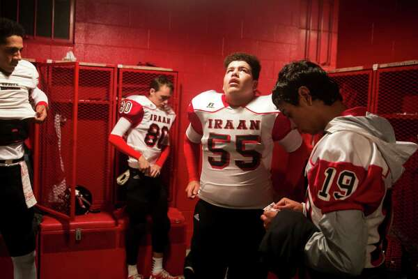 Ivan Castilla, 16, a football player for the Iraan High School Braves, prepares for the quarter-final game in Colorado City, Texas, Dec. 2, 2016. Hours after an away-game victory, a bus full of Iraan High's cheerleaders was involved in a rainy collision with an 18-wheeler, injuring many in the squad and killing the sponsor of the junior high cheerleaders. (Ilana Panich-Linsman/The New York Times)