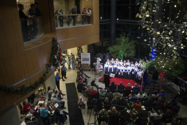 Lyrica, the Center Stage Youth Choir, sing Christmas music during the 35th annual Love Light Trees Ceremony at the Midland MidMichigan Medical Center campus Thursday evening. This year money was raised to provide the hospital with infant warmers.