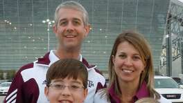 Former Texas A&M senior associate athletic director Jason Cook (top left) poses with his family — wife Leann (top right) and sons Brayden (left) and Jace — outside AT&T Stadium in Arlington at the 2011 Cotton Bowl, which pitted the Aggies against LSU.