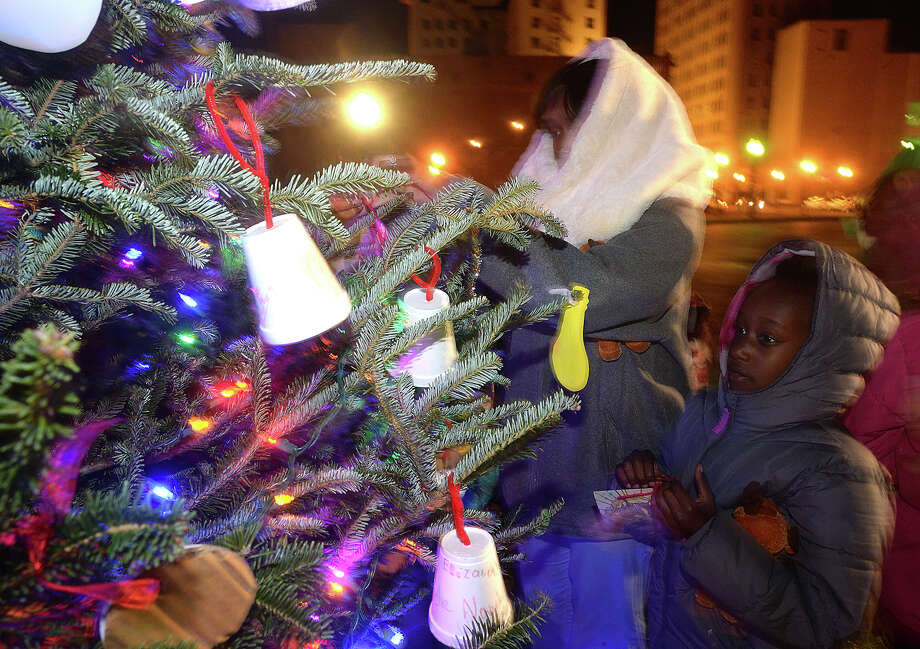 Niyah Tillman, 8, takes in the colorful lights as she and families gather during the annual Beaumont Holiday Tree Lighting event Thursday. Families braved a bitter cold to enjoy the crafts and other holiday themed activities, visits with Santa Claus, and mailing letters to the North Pole before the official lighting of the tree. Photo taken Thursday, December 8, 2016 Kim Brent/The Enterprise Photo: Kim Brent / Beaumont Enterprise
