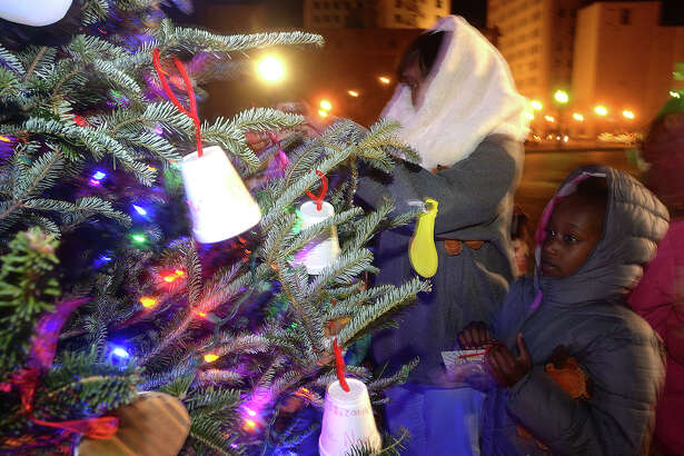 Niyah Tillman, 8, takes in the colorful lights as she and families gather during the annual Beaumont Holiday Tree Lighting event Thursday. Families braved a bitter cold to enjoy the crafts and other holiday themed activities, visits with Santa Claus, and mailing letters to the North Pole before the official lighting of the tree. Photo taken Thursday, December 8, 2016 Kim Brent/The Enterprise
