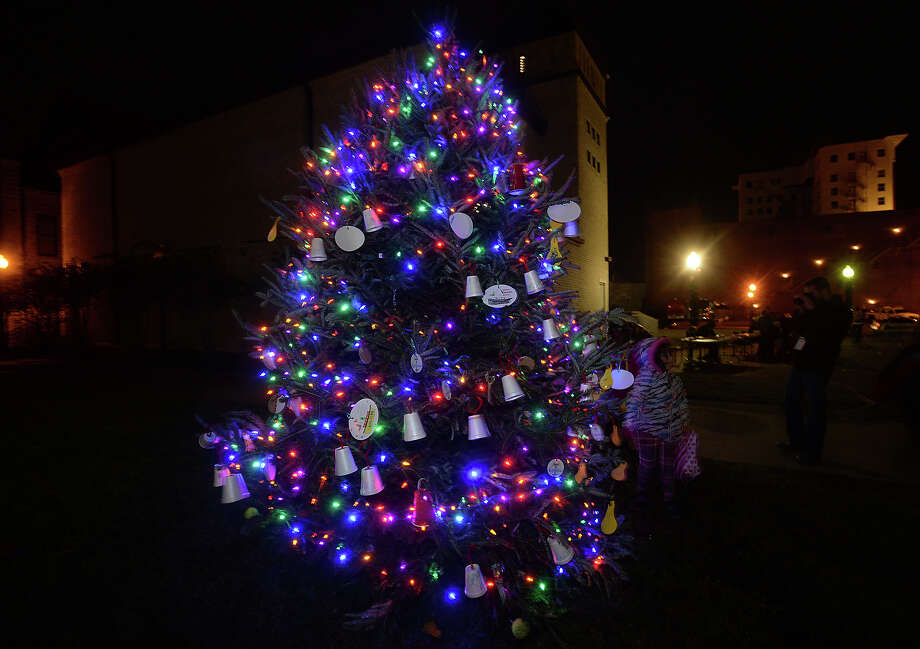 The city tree is lit and decorated with children's hand-made ornaments at the finale of the annual Beaumont Holiday Tree Lighting event Thursday. Families braved a bitter cold to enjoy the crafts and other holiday themed activities, visits with Santa Claus, and mailing letters to the North Pole before the official lighting of the tree. Photo taken Thursday, December 8, 2016 Kim Brent/The Enterprise Photo: Kim Brent / Beaumont Enterprise