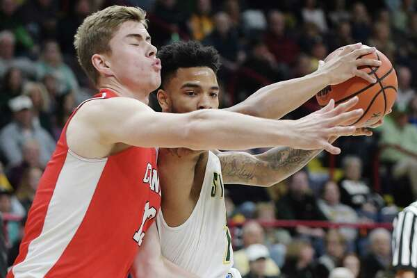 Cornell's Stone Gettings, left, tries to stop Siena's Marquis Wright as he drives to the basket during their game at the Times Union Center on Sunday, Nov. 13, 2016, in Albany, N.Y.   (Paul Buckowski / Times Union)