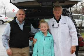 For her 11th birthday party, Braeden Van Wie asked attendees to bring an item for CGHS/SPCA instead of a gift for herself. Pictured in front of a carload of food, toys, and cleaning items for the animals at the shelter are CGHS/SPCA President/CEO Ron Perez, Braeden, and Dr. Jerry Bilinski of Chathams Small Animal Hospital and Medical Director of CGHS/SPCA.