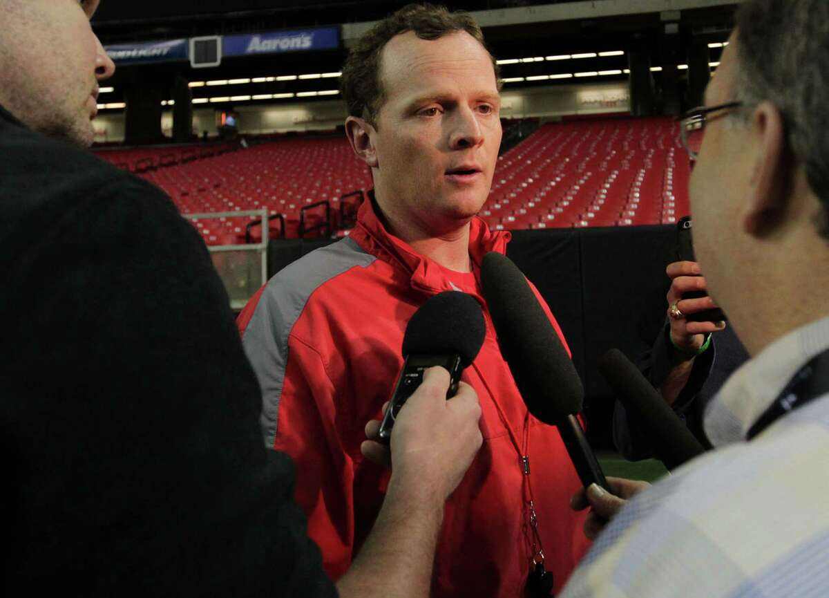UH offensive coordinator Major Applewhite talks to reporters after Monday's practice at the Georgia Dome in Atlanta. ( Elizabeth Conley / Houston Chronicle )
