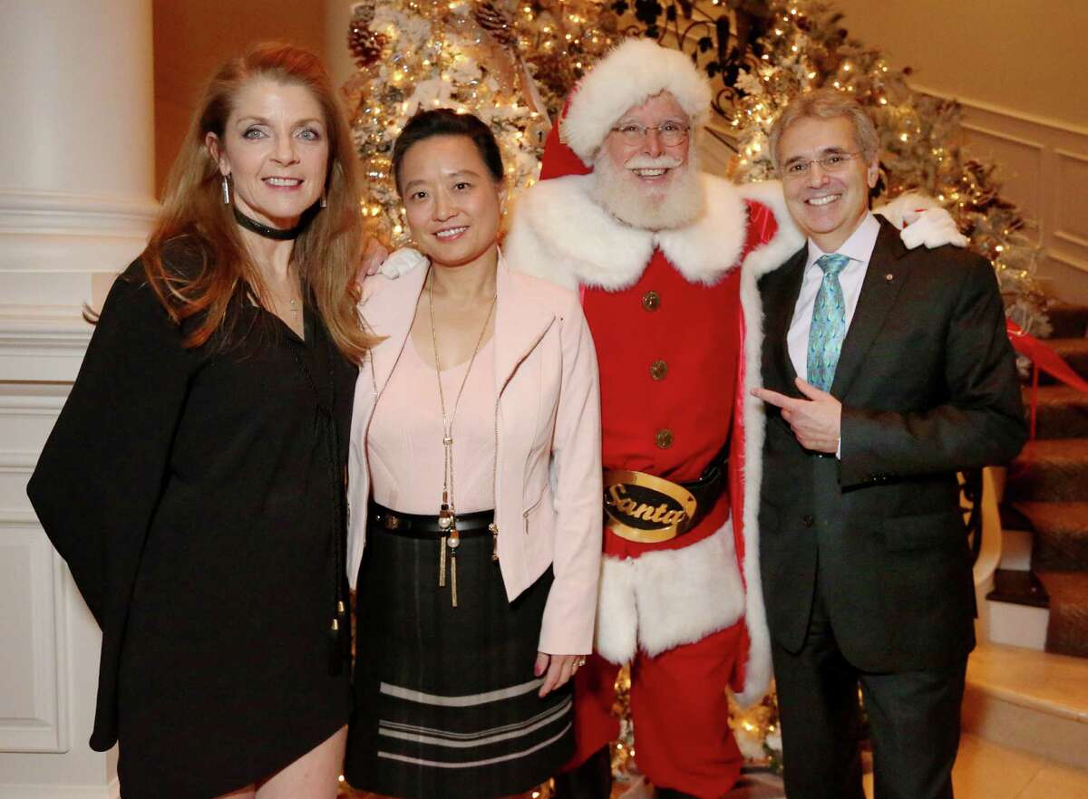 Paige Fertitta, left, Dr. Lynda Chin, Santa and M.D. Anderson President Dr. Ronald A. DePinho.
