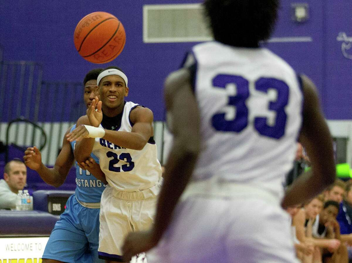 Montgomery guard Kenyura Hill (23) passes to small forward Trey Franklin (33) during the first quarter of a high school boys basketball game at the Montgomery High School Bears Holiday Classic Thursday, Dec. 8, 2016, in Montgomery