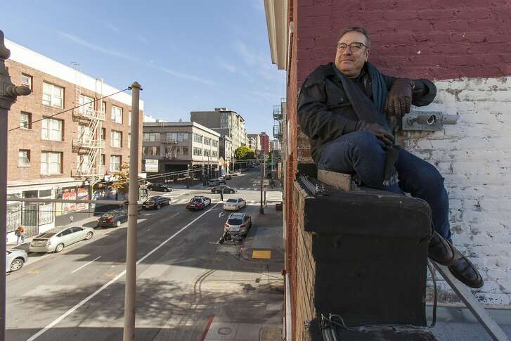 Stanlee Gatti sits on the parapet of his newly renovated Meraki Market building over looking Post Street in the Tenderloin neighborhood in San Francisco, California, USA 6 Dec 2016. (Peter DaSilva/Special to The Chronicle)