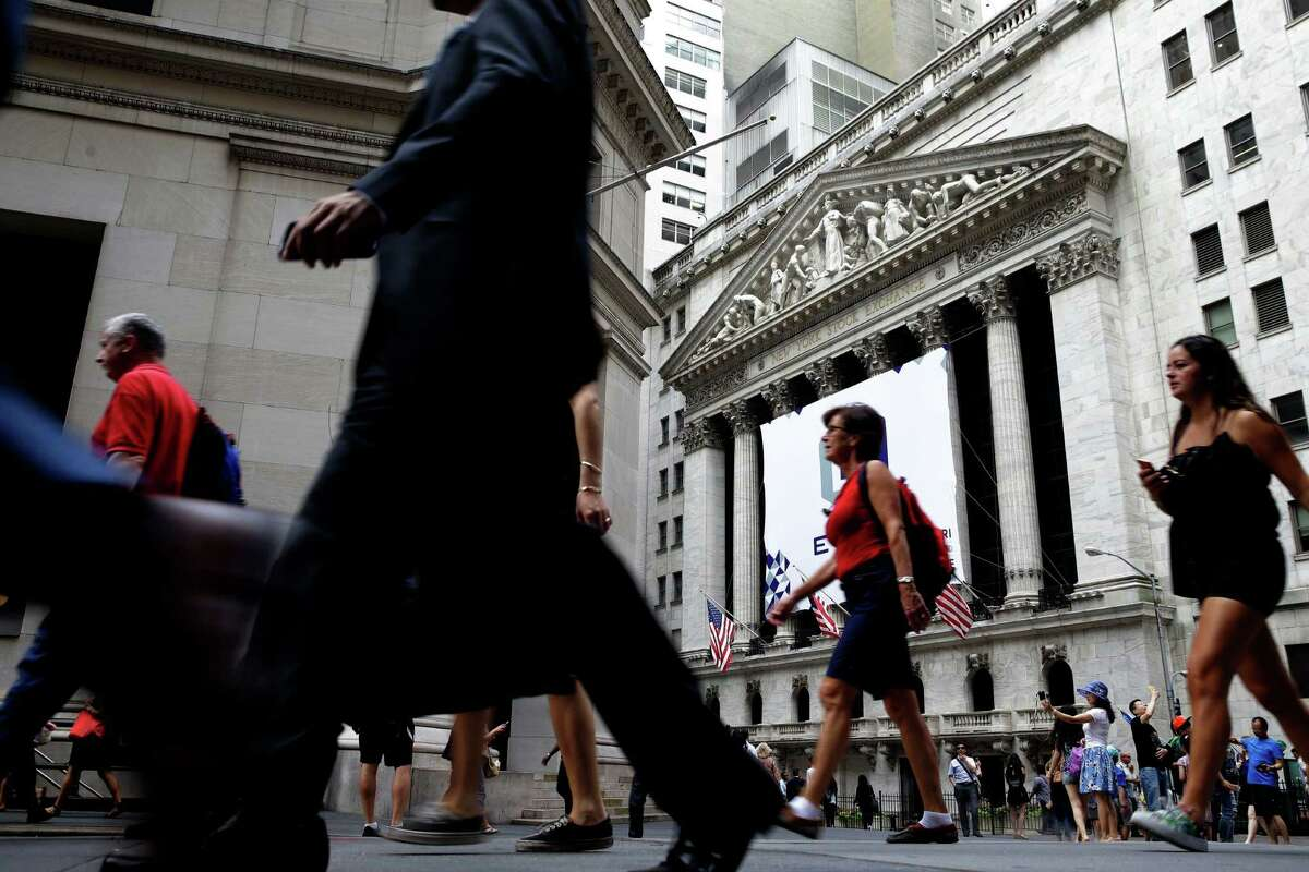 FILE - In this Monday, Aug. 24, 2015, file photo, pedestrians walk past the New York Stock Exchange. On Thursday, Dec. 8, 2016, the Federal Reserve reports on household wealth for the July-September quarter. (AP Photo/Seth Wenig, File)