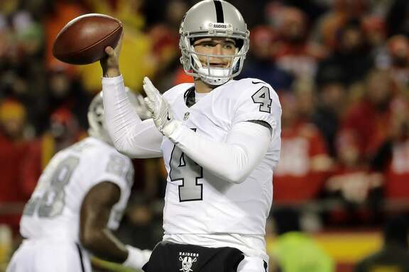 Oakland Raiders quarterback Derek Carr (4) throws during the first half of an NFL football game against the Kansas City Chiefs in Kansas City, Mo., Thursday, Dec. 8, 2016. (AP Photo/Charlie Riedel)