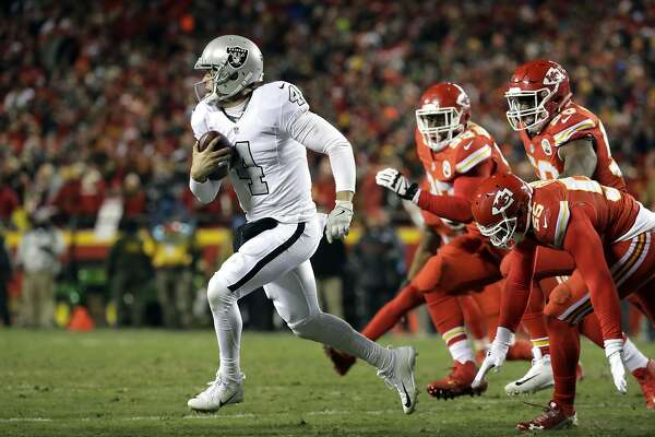 Oakland Raiders quarterback Derek Carr (4) runs away from Kansas City Chiefs linebacker Dee Ford (55), defensive lineman Rakeem Nunez-Roches (99) and linebacker Justin Houston (50) during the first half of an NFL football game in Kansas City, Mo., Thursday, Dec. 8, 2016. (AP Photo/Charlie Riedel)