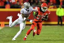 KANSAS CITY, MO - DECEMBER 8: Wide receiver Chris Conley #17 of the Kansas City Chiefs avoids the tackle attempt of cornerback David Amerson #29 of the Oakland Raiders at Arrowhead Stadium during the second quarter of the game on December 8, 2016 in Kansas City, Missouri. (Photo by Peter Aiken/Getty Images) ORG XMIT: 681233985
