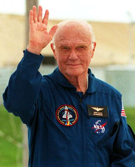 (FILES) This file photo taken on October 8, 1998 shows  US Senator and astronaut John Glenn waving to the media during a shuttle crew interview session at Kennedy Space Center.  Glenn, who made history twice as the first American to orbit the Earth and the first senior citizen to venture into space, has died at the age of 95, the Ohio State University's John Glenn College of Public Affairs said on December 8, 2016. / AFP PHOTO / BRUCE WEAVERBRUCE WEAVER/AFP/Getty Images Photo: BRUCE WEAVER, Stringer / AFP or licensors
