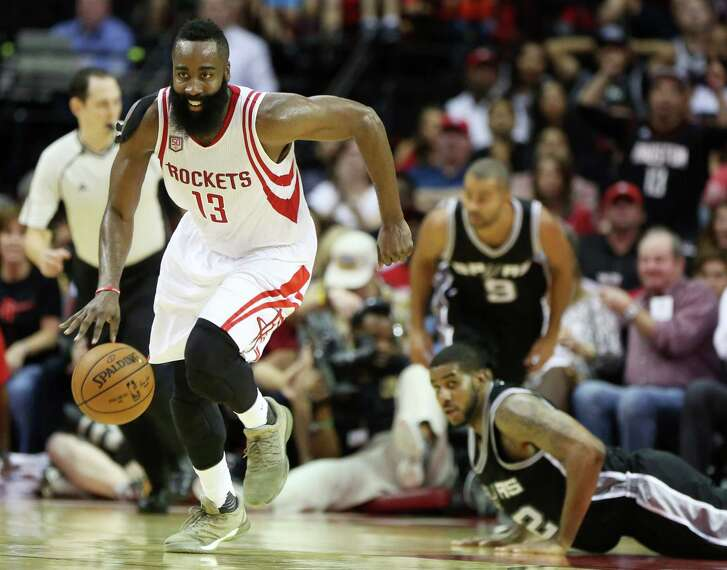 Houston Rockets guard James Harden (13) gets a lose ball from San Antonio Spurs forward LaMarcus Aldridge (12) during the second half of the game Saturday, Nov. 12, 2016, in Houston. The Rockets lost to the Spurs 106-100. ( Yi-Chin Lee / Houston Chronicle )
